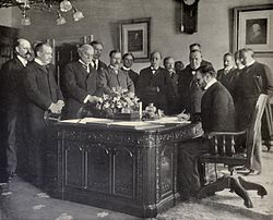 John Hay signs Treaty of Paris, 1899