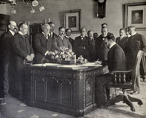 Treaty of Paris (1898) -  John Hay, Secretary of State, signing the memorandum of ratification on behalf of the United States