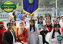 students from south city international school at the christmas parade on park street during kolkata christmas