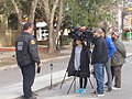 KVUE-TV Reporters and camera personnel taking an interview.jpg
