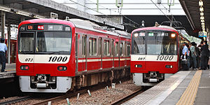 Keikyu N1000 series - Stainless steel (left) and aluminium (right) N1000 series sets in May 2008