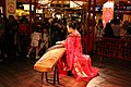 Lady performing Chinese Traditional Music instrument Guzheng.jpg
