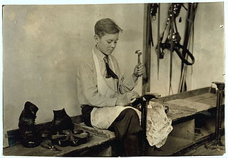 Oklahoma School for the Deaf - Learning to make shoes, 1917.  Photo by Lewis Hine.