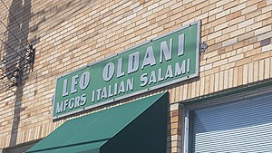 The Hill, St. Louis - Although the salumeria has long been out of business, a sign advertising Leo Oldani Mfgrs Italian Salami still hangs on the building's facade.