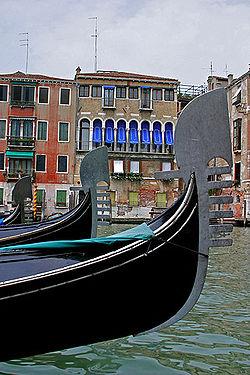 Several gondolas sail down the canals of Venice