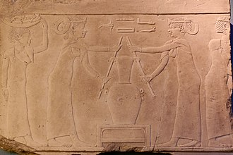Egyptian scene depicting the preparation of lily perfume, 4th century BC Lily perfume Louvre E11162.jpg