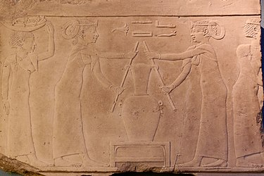 Egyptian scene depicting the preparation of Lily perfume Lily perfume Louvre E11162.jpg