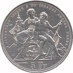 Seated Helvetia and nude man. Helvetia is holding a sword and shield bearing the Swiss cross; nude man is holding a lyre. The figures are seated above a stone tunnel with train emerging. Legend along edge at top, denomination at bottom.