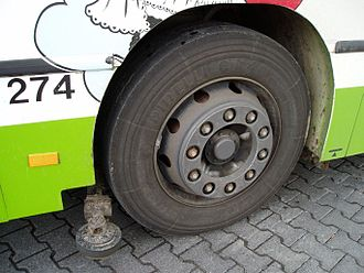 Guided bus - The kerb guide wheel of a guided bus in Mannheim, Germany