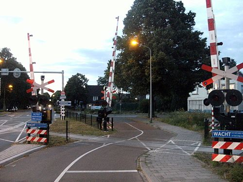 Railway level crossing in the Dutch town of Maastricht (photo by Mark Ahsmann, via Wikimedia Commons)