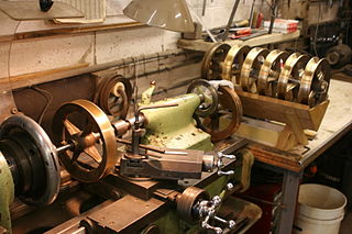 http://commons.wikimedia.org/wiki/File:Machining_Trolley_Wheels.jpg