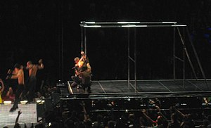 "Jump (Madonna song) - Madonna swivels around the steel equipment with her dancers, during the performance of ""Jump"" on the Confessions Tour."