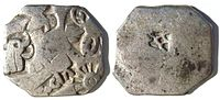 Silver punch-mark coins of the Mauryan empire, bear Buddhist symbols such as the Dharmacakra, the elephant (previous form of the Buddha), the tree under which enlightenment happened, and the burial mound where the Buddha died (obverse). 3rd century BC.