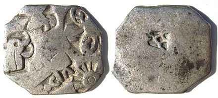 Silver coin of the Maurya Empire, known as rupyarupa, with symbols of wheel and elephant. 3rd century BC. MauryanCoin.JPG