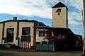 Max Müller Max-Müller-Straße 22 Blick auf die Wöppelmann-Halle von 1915 Tor 7 mit dem Turm Beschrankung rechts neben Pförtnerhaus.jpg