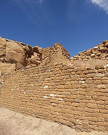 A color picture of a large sandstone masonry wall