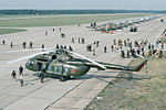 Mi-8 and MiGs (25381973710).jpg