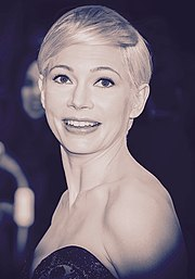 A sepia tone picture of Michelle Williams posing for the camera