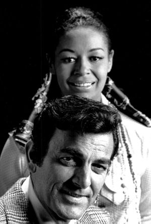 Mike Connors - Connors with Gail Fisher in a publicity photo for Mannix, 1970