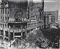 Missouri Athletic Club fire wreckage at the northwest corner of Fourth Street and Washington Avenue. Workers begin to clear the rubble at the street level.jpg