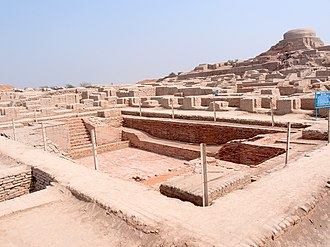 Indus Valley Civilisation - Excavated ruins of Mohenjo-daro, Sindh province, Pakistan, showing  the Great Bath in the foreground.  Mohenjo-daro, on the right bank of the Indus River, is a UNESCO World Heritage Site, the first site in South Asia to be so declared.