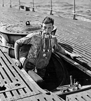 "USS Narwhal (SS-167) - A Momsen lung in use during training – USS V-5 (SC 1) crewman A. L. Rosenkotter exits the submarine's escape hatch wearing the ""Momsen Lung"" emergency escape breathing device during the submarine's sea trials in July 1930. The emergency breathing device was named for its inventor, U.S. Navy submarine rescue pioneer Cdr. Charles ""Swede"" Momsen. The submarine V-5 was later renamed USS Narwhal (SS 167)."
