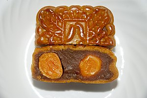 Lotus seed paste - Mooncake with double yolk and lotus seed paste (including salted duck egg yolk and lotus seed paste as fillings, whereas cereal powder as an ingredient on surface)