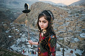 Girl with torch on mountainside
