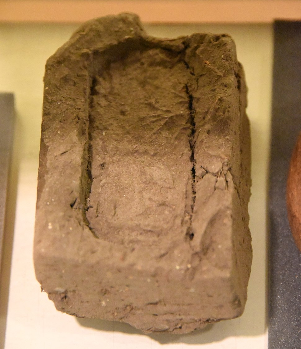 Mud-brick stamped with seal impression of raised relief of the Treasury of the Vizier. From Lahun, Fayum, Egypt. 12th Dynasty. The Petrie Museum of Egyptian Archaeology, London