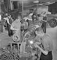 National Fire Service on War Production- War work in a Fire Station, London, England, UK, 1943 D17206.jpg