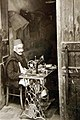 Native craftsman using sewing machine in Tripoli, Libya 1943 (27015174410).jpg