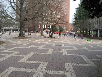 Main Campus of North Carolina State University - The Brickyard with the D.H. Hill Library tower in the background and Harrelson Hall on the right.