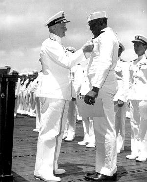 Doris Miller - Chester W. Nimitz pins the Navy Cross on Doris Miller, at ceremony on board USS Enterprise (CV-6) at Pearl Harbor, May 27, 1942.