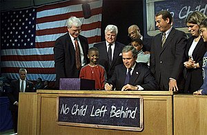 Then-President George W. Bush signs the No Chi...