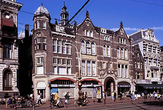 Heilige Stede - Storefronts on the Rokin today that were built as part of the complex in 1908, behind them the church tower can be seen