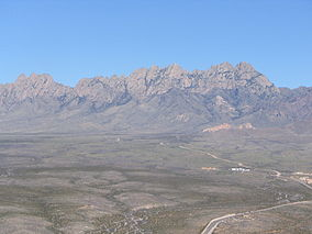 An aerial photo of the Organ Mountains from the west