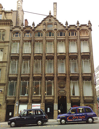 Skyscraper - Oriel Chambers, Liverpool. The world's first glass curtain walled building. The stone mullions are decorative.