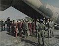 PAVN prisoners board a C-130 at Phu Quoc, 14 February 1973.jpg