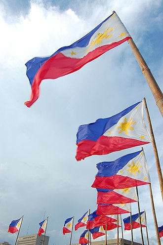 Flag of the Philippines - Philippine flags on bamboo poles