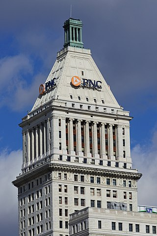 Designed by Cass Gilbert, the PNC Tower in Cincinnati, Ohio, is a prime example of a neoclassical skyscraper with an elaborate Hellenic architecture in the upper portion of the tower