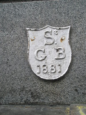 St George Botolph Lane - Parish boundary marker, set in a wall on Fish Street Hill