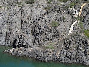 Shear zone - Pegmatite dyke offset by a steeply-dipping dextral shear zone, Cap de Creus