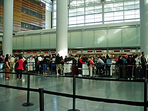 Balikbayan box - Travellers stand in line for a flight to the Philippines carrying balikbayan boxes.