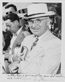 Photograph of President Truman smiling and checking his watch upon arrival in Miami (with an inscription from the... - NARA - 200165.tif