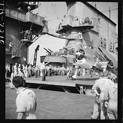 Plane on board the USS Saratoga (CV-3). Plane parker signaling to pilot of F6F. - NARA - 520893.jpg