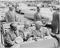 President Harry S. Truman, President Romulo Gallegos of Venezuela, and an unidentified man sitting in a convertible... - NARA - 199910.tif