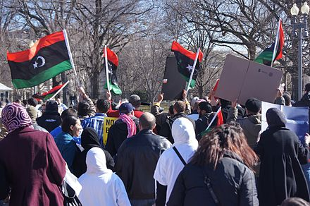 Protesters in Washington calling for a military intervention in Libya in 2011. Protesting Libya outside the White House, Washington, D.C..jpg