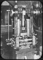 Punching Machine used for punching out blanks or planchets from uniform strips of metal. - NARA - 296576.tif