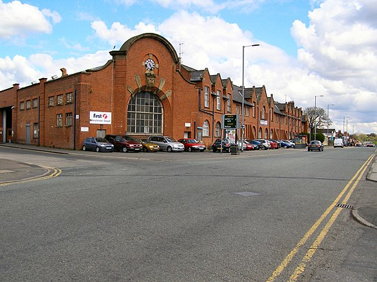 Front of the bus depot on Queens Road; the Museum of Transport occupies a bus depot to the rear of this building Queens Road Bus Depot, Cheetham Hill.jpg