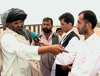 Radio Free Europe/Radio Liberty - A reporter for RFE/RL's Afghan Service interviews a citizen in Helmand, Afghanistan.